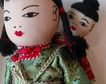 Vintage cloth Asian doll with baby