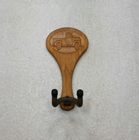 Guitar hanger old pickup truck player by
