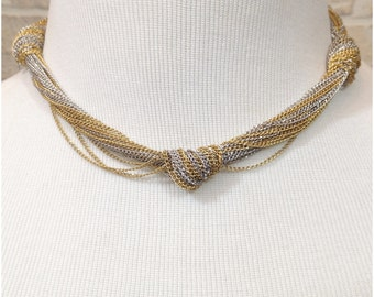 Short necklace of silver and gold tone knotted chain