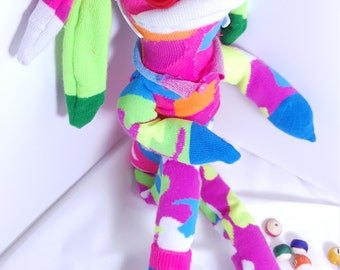 Sissy, the sassy sock monster who comes wearing her retro, pink tinted sunglasses!