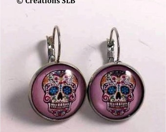 Dangle earrings with pink cabochons and candy skull