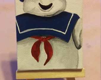 Miniature Stay Puft Marshmallow Man canvas painting on easel
