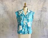 womens vintage Hawaiian shirt by Hilo Hatties . 70s 1980s Hawaiian blouse, bright aqua blue and white Hibiscus flowers . medium large