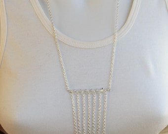 Drapes of silver chain and crystals