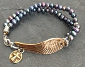 Angel wing bracelet - 'On a wing and a prayer' pearl knotted chic jewellery by Mollymoojewels