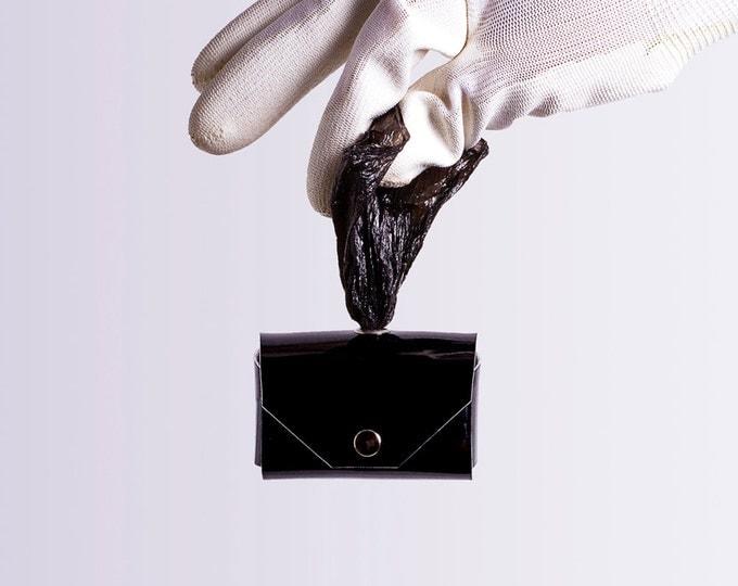 black holographic dog waste bag holder