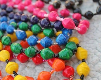 Vibrant Necklace Handmade in Uganda with Paper Beads for a Good Cause Nonprofit Non Profit pink green yellow orange purple red black
