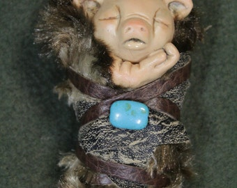 Troll Baby Changeling Little Hamlet in his fuzzy blankie cuddling measures 4 inches