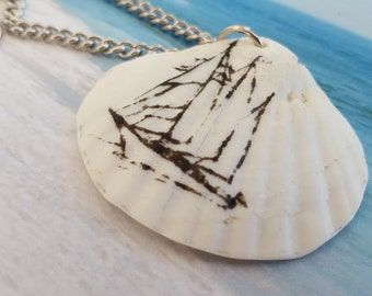 "White Seashell with Black Printed Vintage Ship Pendant on 18 Inch Silver Link Chain Nautical Necklace. Shell is 1.75"" x 1.5"". Lobster Clasp."