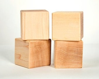 "Maple baby blocks. Solid Maple approximately 2"" x 2"" 4 blocks"