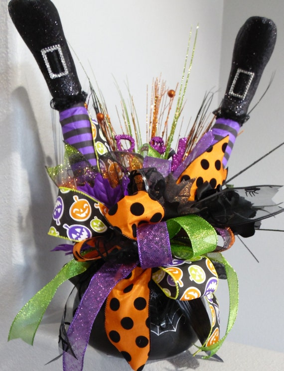 Witch cauldron centerpiece witch legs centerpiece halloween for Deco de table halloween