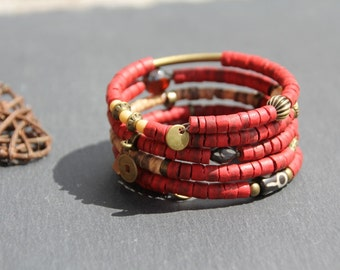 ethnic cuff bracelet / bangle, memory wire, red and bronze, coco slices, horn, wood, seeds, charms