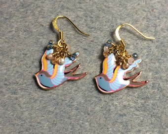 Light blue, peach and pink enamel dove charm earrings adorned with tiny dangling light blue, peach and pink Chinese crystal beads.