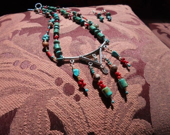 Turquoise, coral, and sterling multi strand necklace and earrings.