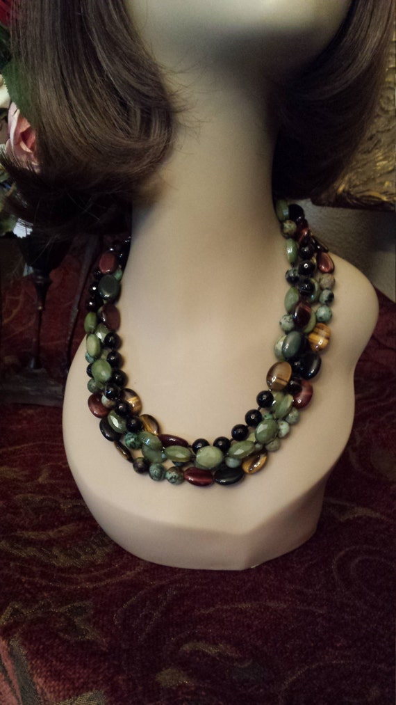 Four strand beaded necklace made with faceted black onyx, tiger eye, green turquoise and faceted glass artist beads