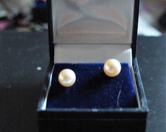 A Pair of Pink Pearl Earrings