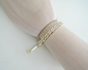 Silver bracelet with baguettes