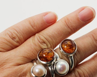 Adjustable Ring made of Amber and pearl set on sterling silver 925e