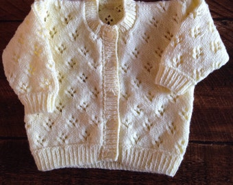 Pretty hand knitted baby cardigan available in choice of colours. Suitable for both boys and girls.