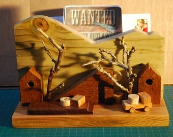Wooden scene letter rack with hardwoods. One off