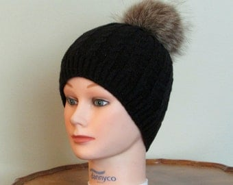 Hat with racoon fur pom pom, lined with fleece.