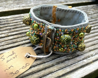 Hand made demin cuff with rhinestuds and beads
