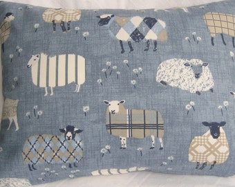 Fun Sheep cushion in soft blues.