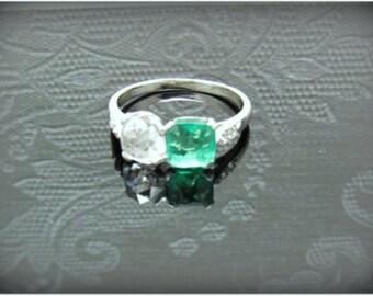 Antique emerald-diamond platinum ring
