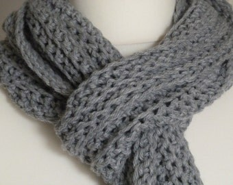 Chunky hand knitted grey scarf made from a wool and acrylic mix yarn