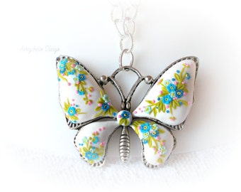 Jewelry on the neck.brooch,ring,butterflypendant chain of polymer clay.(white with blue)handmade.flowersIn the technique of filigree floral.