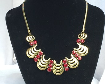 Egyptian Revival style gold tone and red rhinestone bib necklace