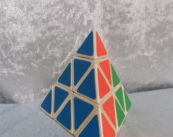 Vintage pyramid puzzle game made of wood.