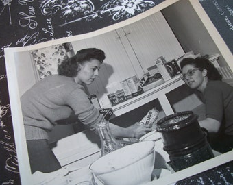 Vintage 1950s  Black and White Photo of Housewifes Putting Away Groceries