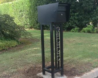 Mid century steel mailbox stand with locking mailbox