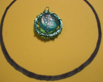 Green wire wrapped around large green bead, pendant