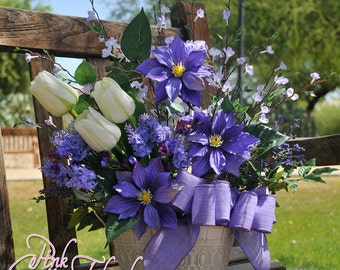 Purple Clematis Silk Floral Arrangement. This arrangement is made to order.