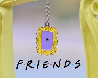 Friends tv show peephole frame friends frame by laretrotienda for Marco puerta friends