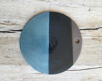 Blue ceramic cheese board or trivet hand made and glazed in different colors.