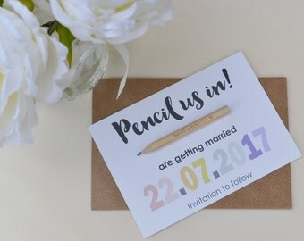 Magnetic 'Pencil us in' Save the Dates, with engraved pencil.
