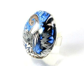 black and blue polymer clay ring