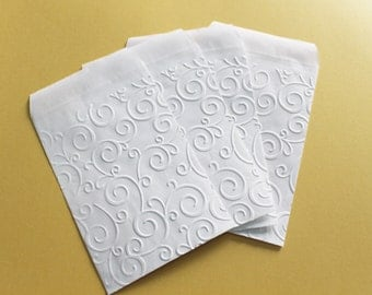 Paper carrier bags with embossed pattern measures 4 x 6