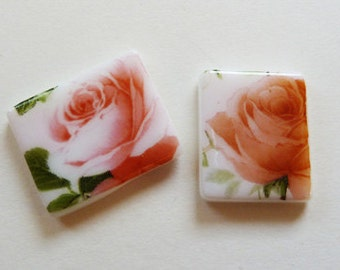 Pair of fused glass cabochons with pink peach orange rose pattern