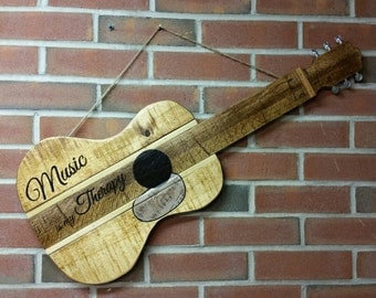 "Wood guitar sign ""Music is my therapy"""
