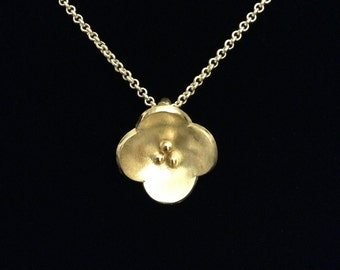 Silver flower with 14K gold