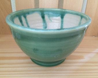 Green and white ceramic bowl