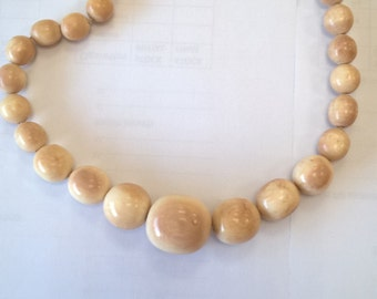 former bone necklace, natural material, ivory
