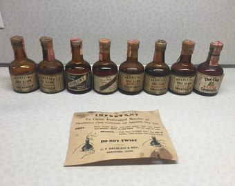 Set of 11 Heublein's mini liquor bottles