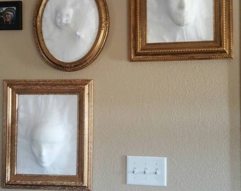 Decorative ghost wall hangings.