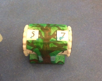 Handpainted life counter. Green tree with blue sky.