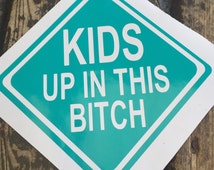 Kids up in this bitch decal! Baby on board decal with sass. Teal version. Perfect for car, truck, or van.